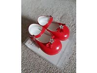 Patent red baby shoes