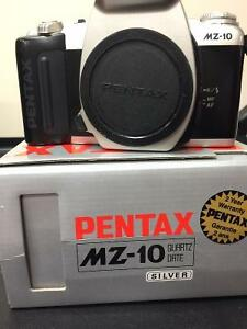 PENTAX CAMERA AND LENS - ALSO CANON CAMERA $50