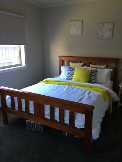 Queen sized timber bed frame with matress