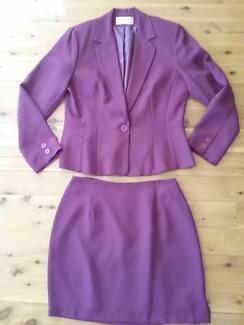 ROCKMAN'S Maroon suit. Jacket size 14, skirt size 12.