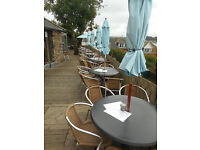 Outdoor Cafe Tables - 15 or more to sell, some with umbrellas and stands