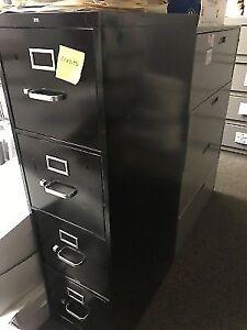 Black 4 drawer letter sized file cabinet.