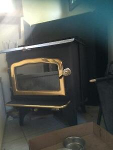 Heritage high eifishancy air tight wood stove with all the pipes