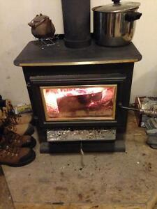 Wood stove with blower.