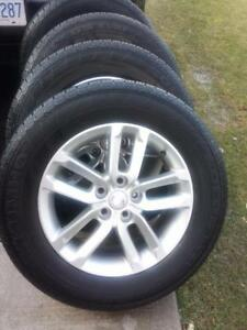 KIA SORENTO 17 INCH FACTORY OEM WHEELS WITH KUMHO HIGH PERFORMANCE 235 / 65 / 17 ALL SEASON TIRES.