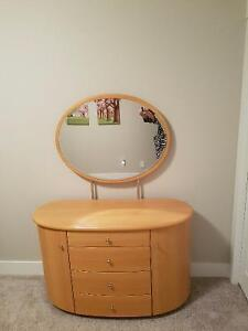Beautiful commode with  a mirror. Will lighten up any  bedroom