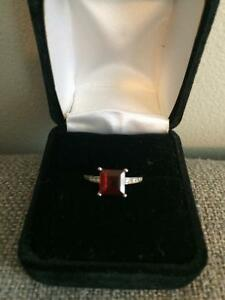 Beautiful one of a kind garnet and diamond ring