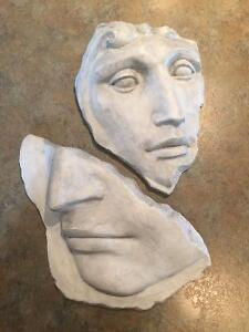 Two Roman Stone Faces