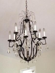 Stunning vintage iron and crystal chandelier!