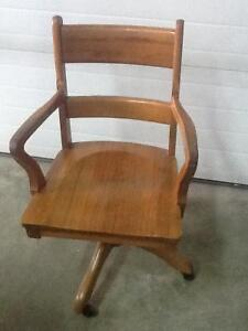 Antique sold wood office chair...from 1940's .