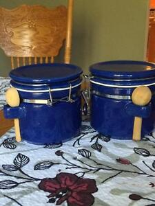 Two blue ceramic canisters