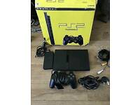 Slim ps2 in the box with some games/ cash or swaps