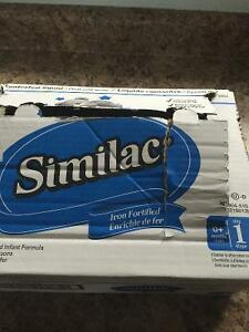7 unopened cans of Similac concentrated liquid formula