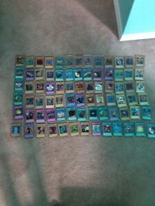 Yu-Gi-Uh Trading cards by Konami (~90 cards) $40
