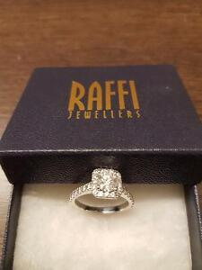 Stunning halo style solitaire engagement ring