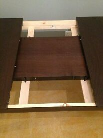 GREAT OPPORTUNITY! Brown dining extandable IKEA table, 1 year old, very good condition for 10 guess.