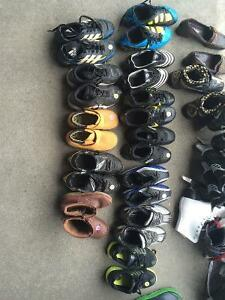 Lots of soccer cleats + shoes