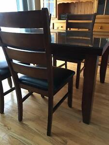 Beautiful Solid Wood table with Glad top, with matching chairs