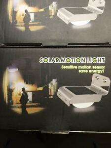 New out door motion lights 100% solar powered