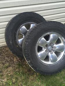 four dodge rims with tires