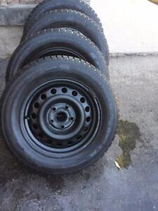 VOLKSWAGON GOLF HIGH PERFORMANCE GISLAVED NORDFROST  WINTER TIRES 195 / 65 / 15 ON FACTORY OEM STEEL RIMS.