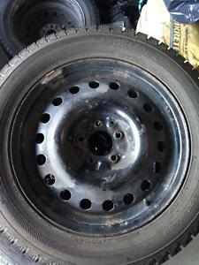 "Pair of 5 Bolt Chev 17"" rims with Yokohama ice Guard tires"