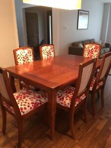 Solid Tasmanian oak dining table with new-upholstered chairs