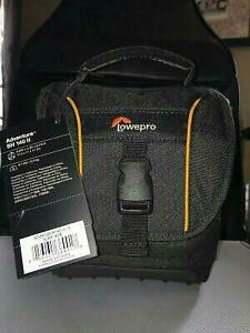 camera bag and Canon lens