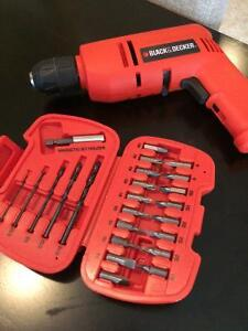 Black and Decker electric drill and screwdriver with bits