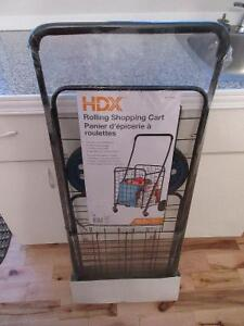 New in plastic grocery cart