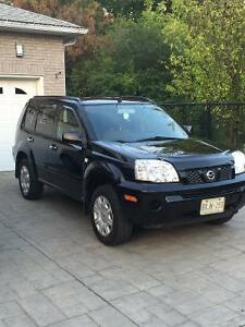 2005 Nissan SUV, very clean car. With set of winters