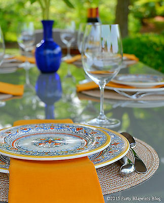 Amp up your al fresco dining. Set a simple but special table complete with china, cloth napkins, wine glasses.