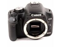 Canon 500d + 18-55mm lens + charger + vertical grip + two batteries