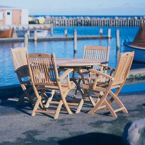 wooden patio table with two chairs