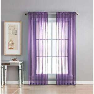 pair of sheer purple curtain panels