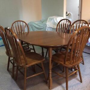 Solid Oak dining room table & six chairs