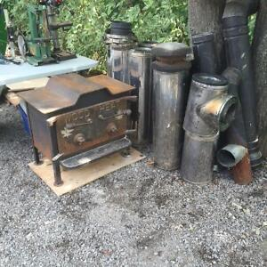 Large Wood Stove c/w 21' of Stainless Dbl Pipe & Misc Bits Kingston Kingston Area image 1