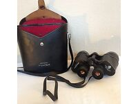 PENTAX 5.5 10x50 field binoculars + leather case. VG condition.