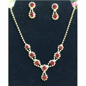Vintage ruby and clear rhinestone necklace and matching earrings
