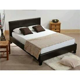 Double, brown, leather bed, with, quilted, spring, mattress.