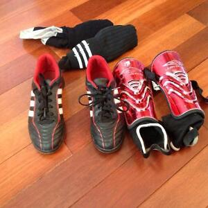 Kids soccer shoes and ect size 5.5