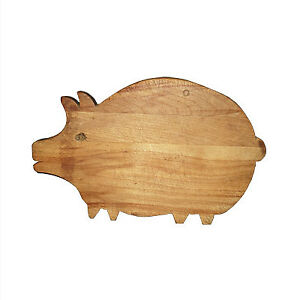 Old wooden cutting board in the shape of a pig