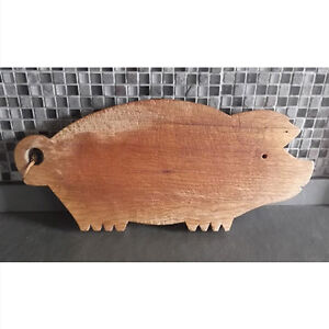 Primitive wooden cutting boards in the shape of a pig