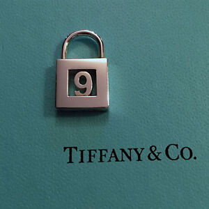 Sterling silver Tiffany and Co. number 9 lock charm. Classic!