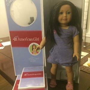 American Girl doll, outfits and brush