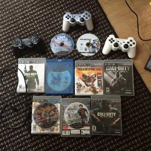3 PS3 Controllers, 1 charger and 9 games $100 OBO