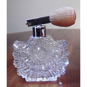 Antique cut crystal perfume bottle with atomizer.