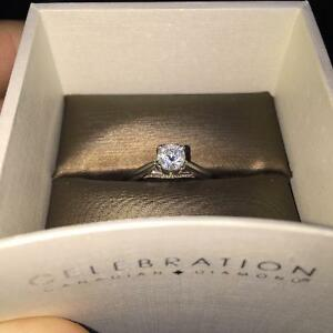 18 Karat White Gold Engagement Ring with .53 CT Canada Dimond