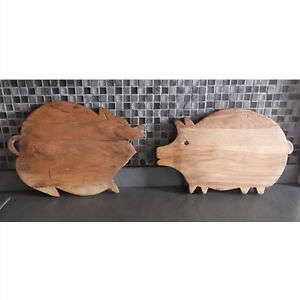 Pair of old wooden cutting boards in the shape of a pig