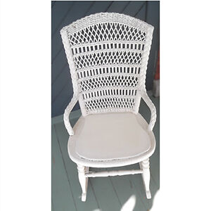 Antique white rattan-back rocking chair